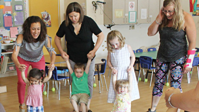 At left, First Steps teacher Susanna Brown leads the Exploration Zone class at the Ann Arbor Family and Preschool Center, 2775 Boardwalk Drive.