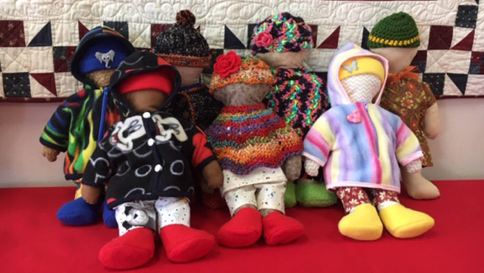 Dolls ready to be delivered to young patients at C.S. Mott Children's Hospital donated by The Quilting Season in Saline