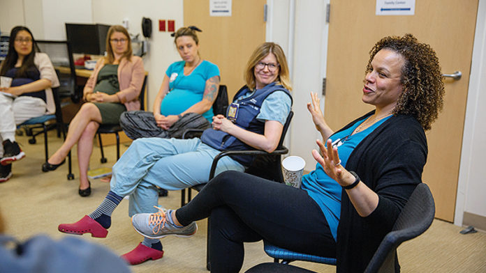Expectant parents engaging during a CenteringPregnancy® meeting. Photo credit: Brian McCullough