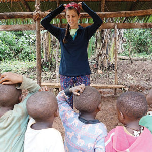 Sarah Strader, Ann Arbor native and founder of Two Rabbits, facilitates a lesson for Baka children in Cameroon. Photo contributed by Sarah Strader