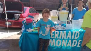 Young entrepreneurs operate lemonade stands while learning about business and finance with the help of national organization Lemonade Day. Image courtesy of Godfrey Aguwa Jr.
